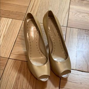 Tan patent leather peep toe pumps